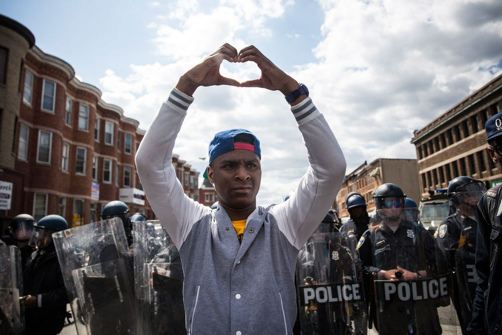 During a protest near the CVS pharmacy that was set on fire during rioting after the funeral of Freddie Gray, on April 28, 2015 in Baltimore, Maryland. (Photo: Andrew Burton/Getty Images)