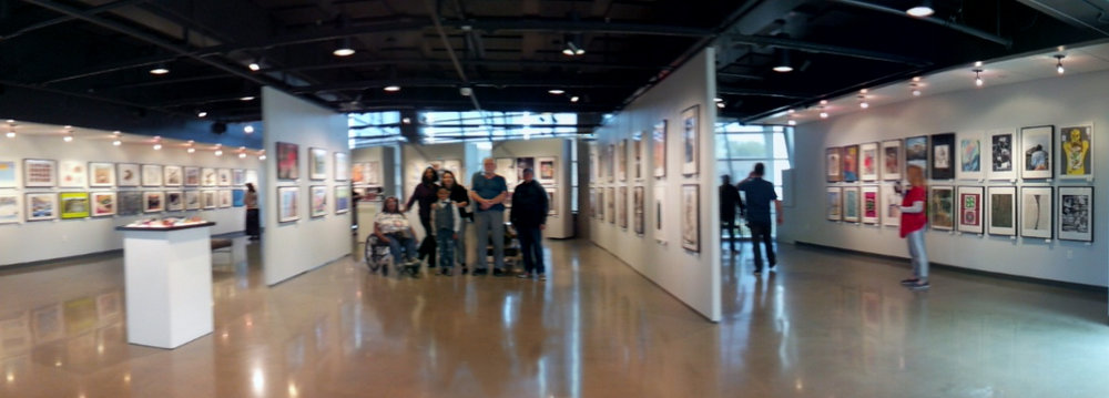 Heninger village residents stand proudly among their artworks on display at coastline gallery in newport beach