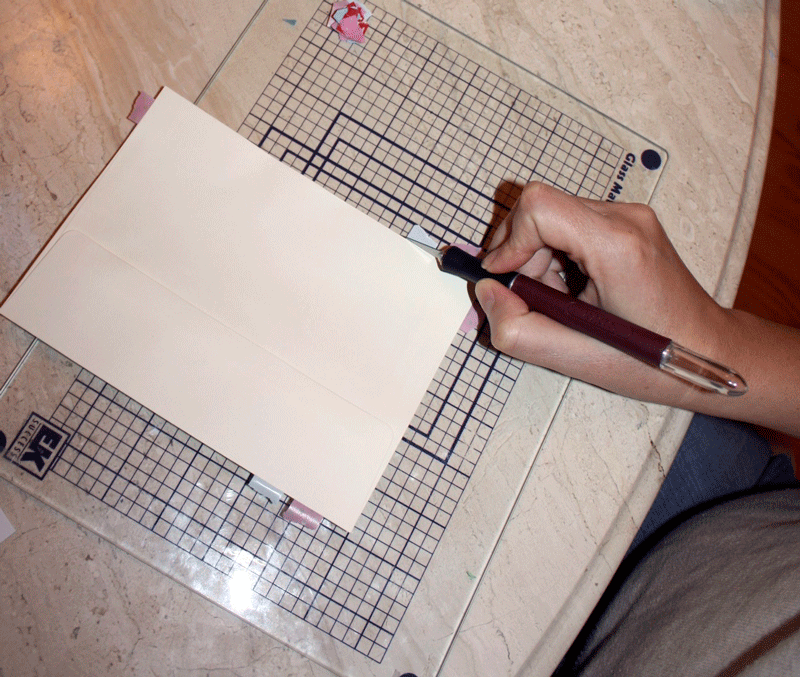 Annoying, but very rewarding - as each washi tape strip is trimmed the envelopes begin looking professionally decorated!