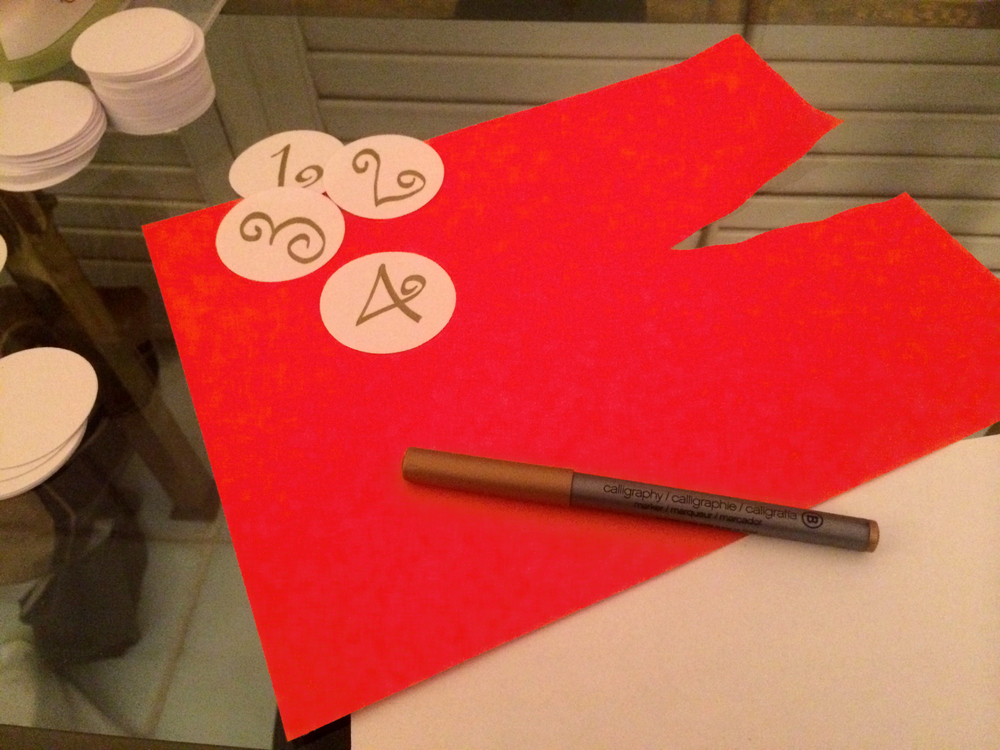 "If you don't like your handwriting, print out festive numbers using Pages or Word and glue them on.  Also, you can google something like, ""Christmas fonts"" and see if a font strikes your fancy.  If it does, just try to imitate the numbers as best you can with the gold pen."