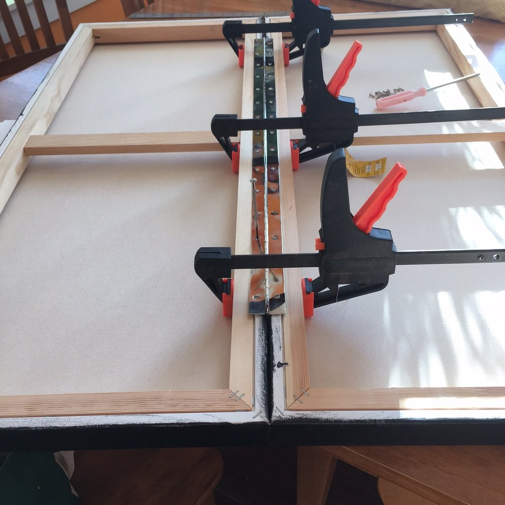 We clamped the two canvases together to screw on the hinge.  This kept everything neat and tidy and lined up.