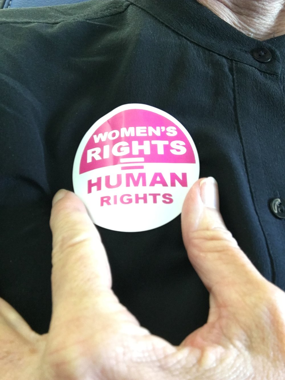 The abbot received this button from a marcher on the plane to DC