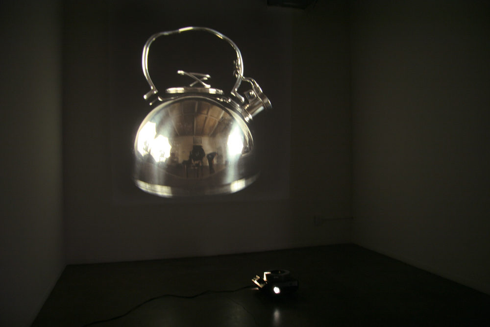 Argent, 2006 slide projector, mirror, 16 slides in continuous loop