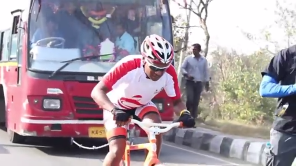 BICYCLIST PULLS BUS IN BANGALORE