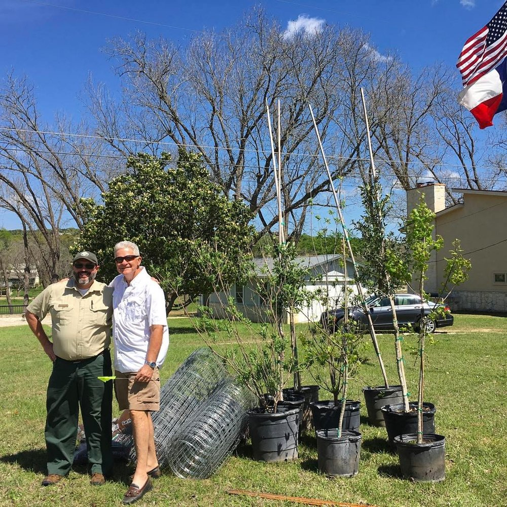 BRAD HAMEL FROM TEXAS A&M FOREST SERVICE VISITS WITH A RESIDENT TO MARK PROPER PLANTING LOCATIONS.