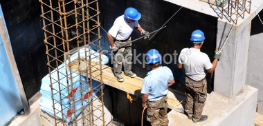 stock-photo-13835900-working-at-a-construction-site.jpg