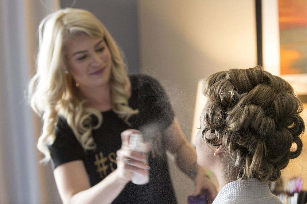 bride-getting-hair-and-makeup-done