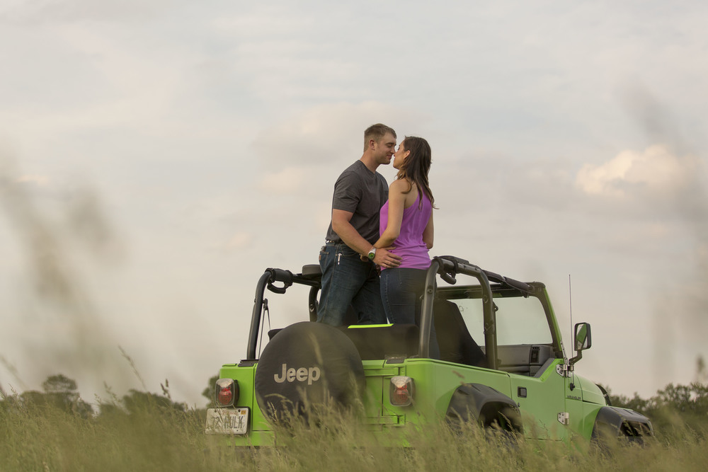 couple-standing-in-back-of-jeep