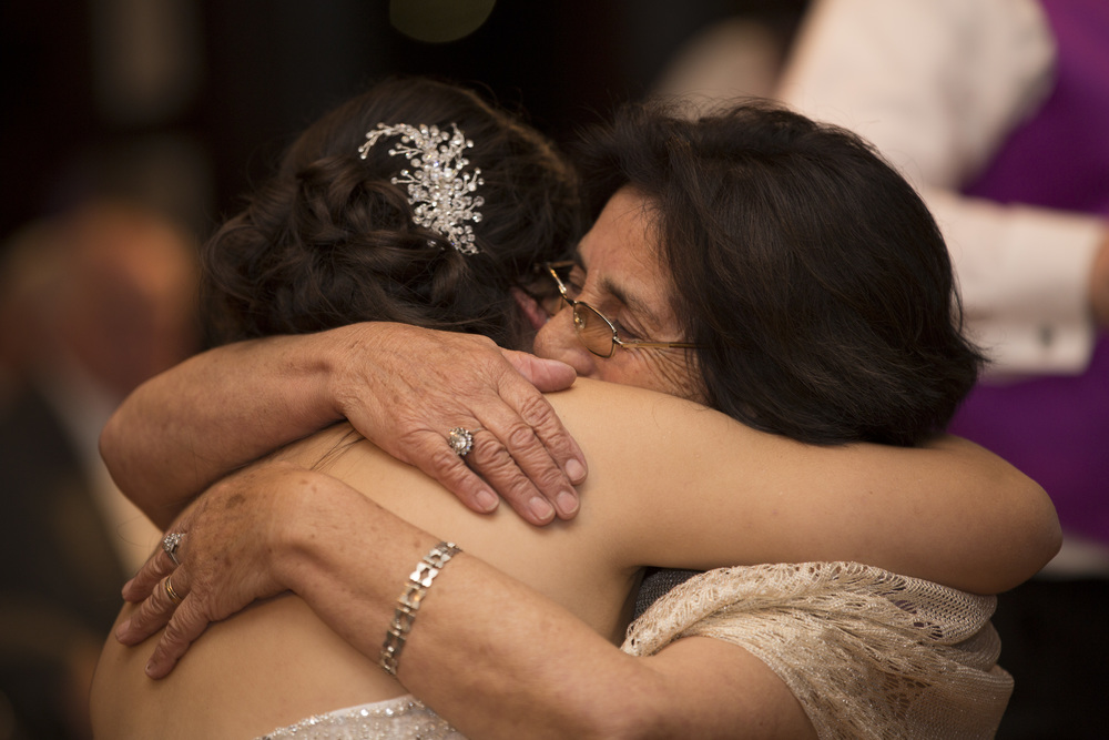 bride being hugged by grandmother