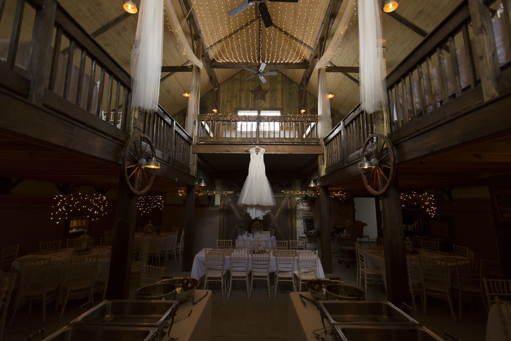 wedding-dress-hanging-at-a-fair-barn