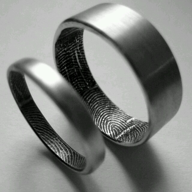 Titanium rings with custom Fingerprint interior option