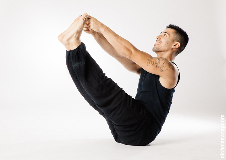Navasana (boat pose) - is a compact pose that requires you to draw everything toward your center: