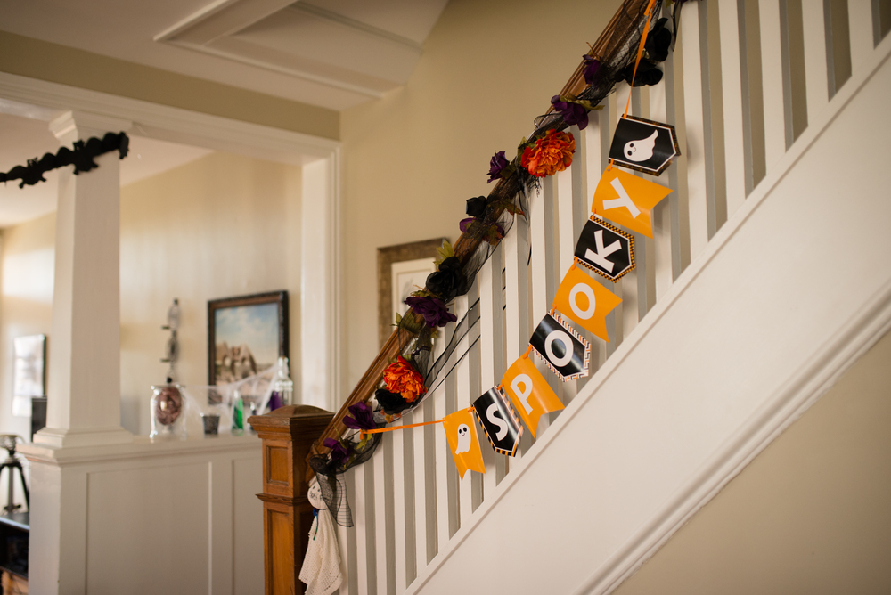 We bought ribbon and silk flowers from the dollar store made a Halloween Garland for the banister.