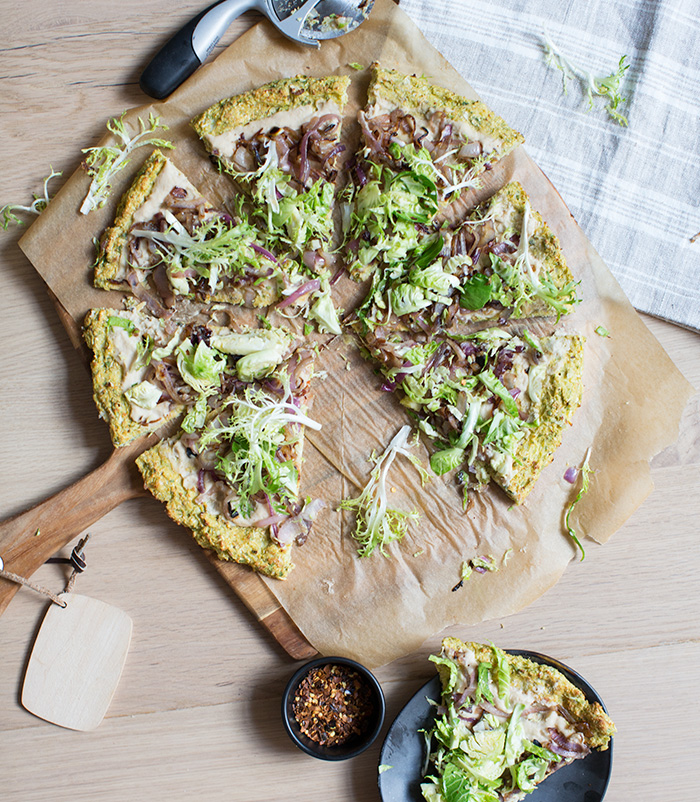 cauliflower + brussels sprout crust pizza with a white bean spread, caramelized onions + shredded sprouts | what's cooking good looking