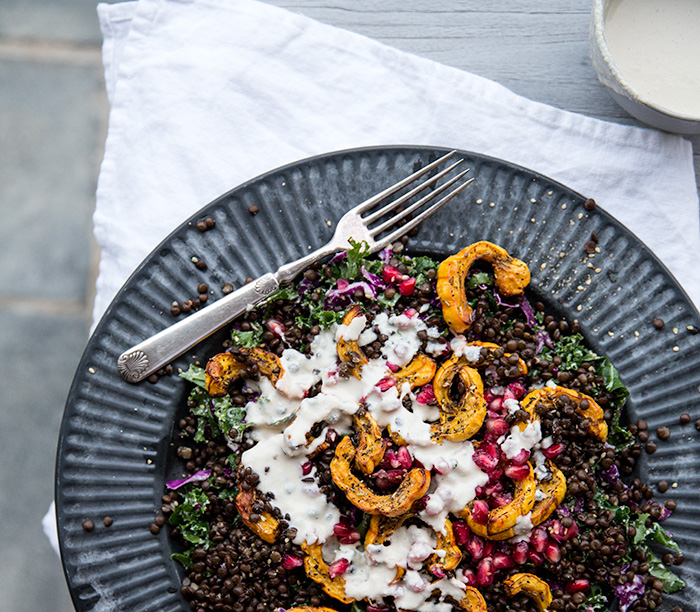 squash salad with lentils + pomegranates with a roasted garlic cream