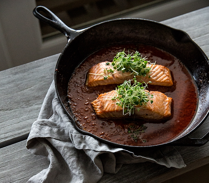salmon + spicy caraway tomato sauce