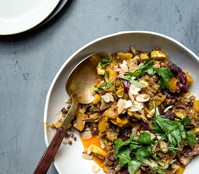 harissa + coconut milk baked deliata squash with lentils + toasted almonds