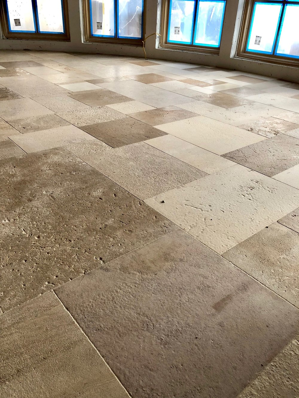 An up close and personal look and the antique limestone. Check out the various colors and textures! The fun thing about this floor is that the pattern was not predetermined—it was laid at random according to how each individual piece fit. We love how it turned out!