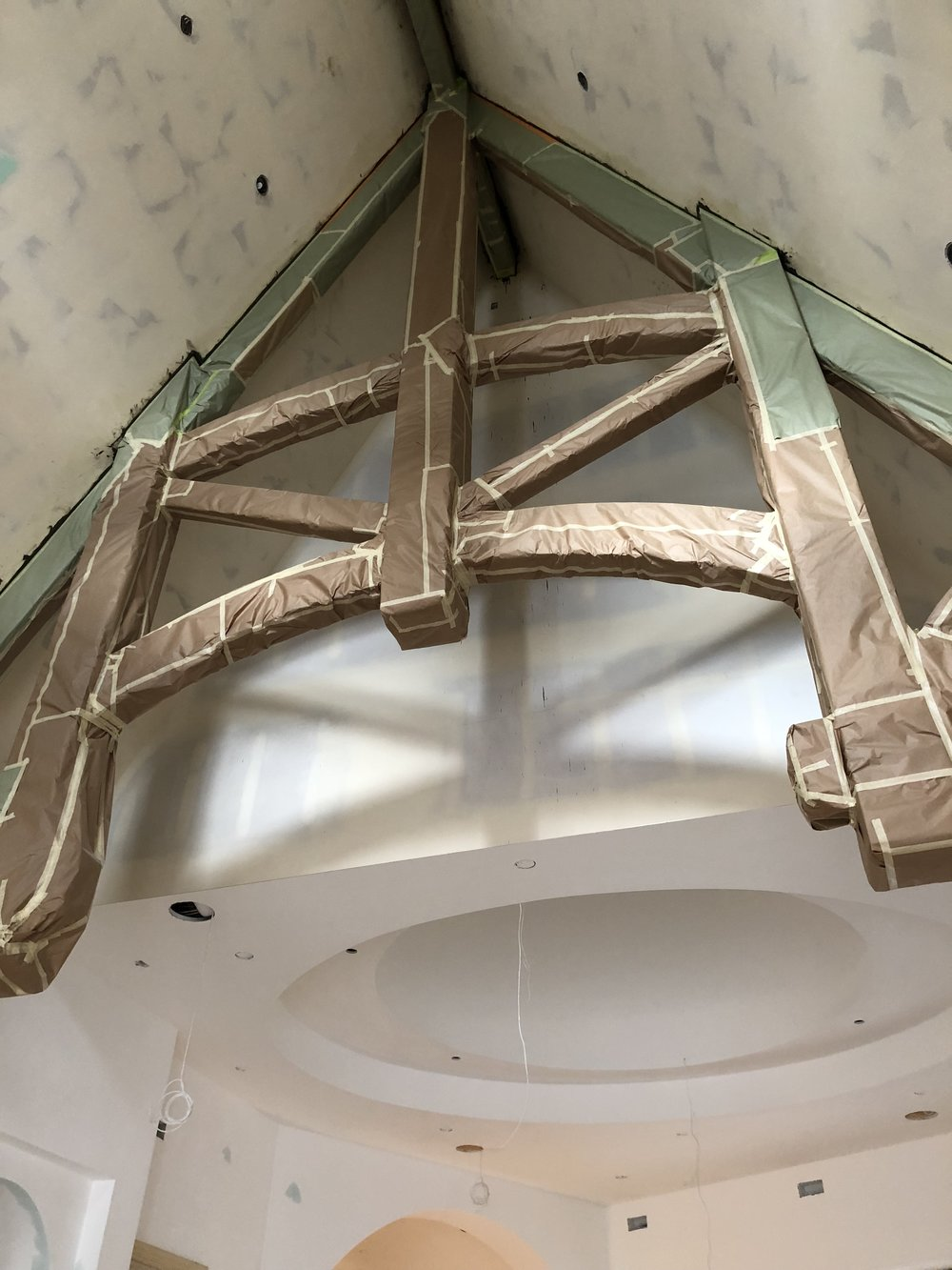 This is the second beam that is part of the same great room space. Just behind it you can see the inside of the largest turret (see our turrets post!) and some of the lighting prep going in!