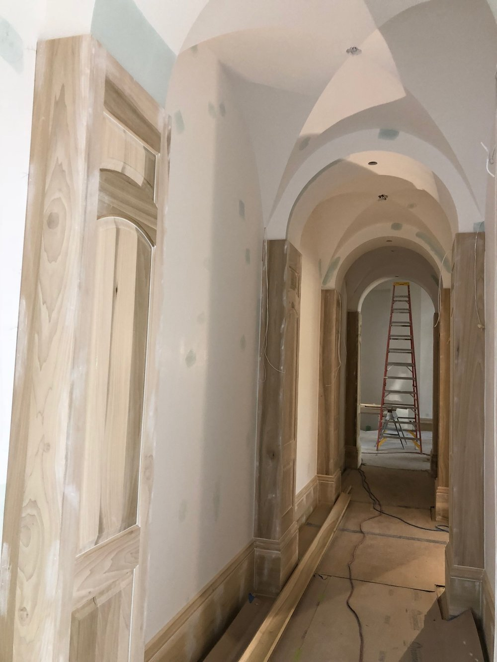 Baseboards all down this amazing hallway.