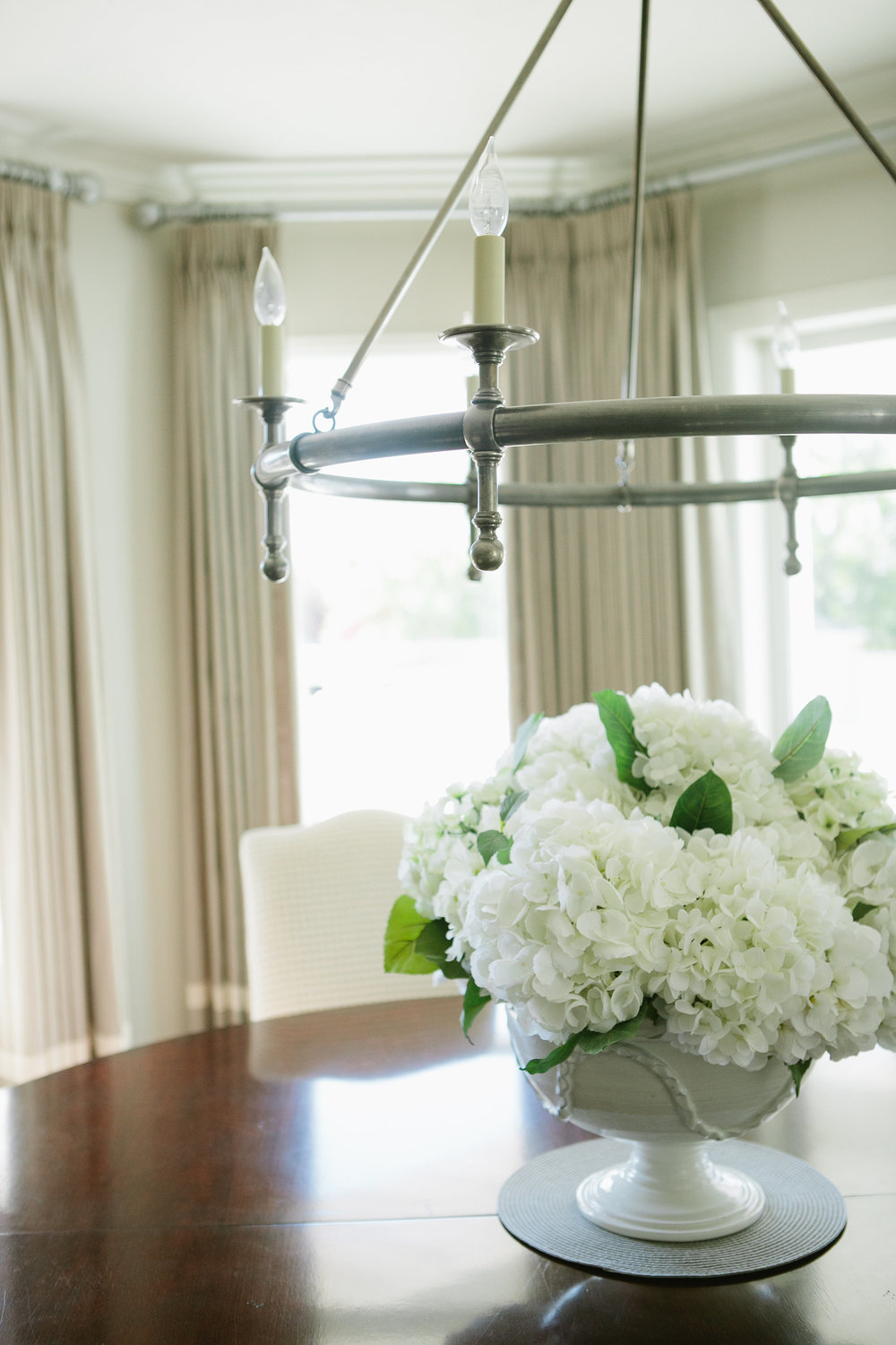 These gorgeous white hydrangea are always a favorite. They really make this dining space come alive!