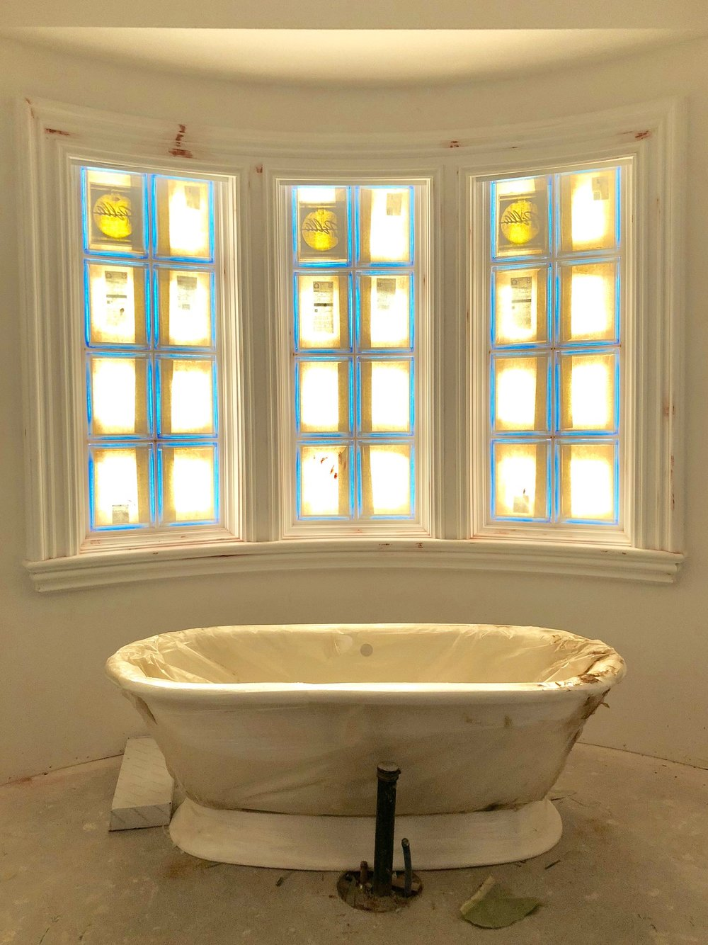 The master bathroom is big and beautiful, and this freestanding white porcelain bathtub adds a soft yet beautiful focal point that is easy to love. And could we love those windows any more?