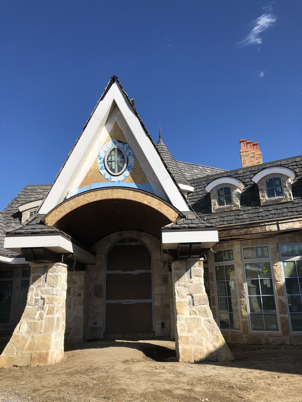 OK, we know this isn't the back of the house, but we just love this picture! The sky is so blue and the craftsmanship on this home is just so amazing.