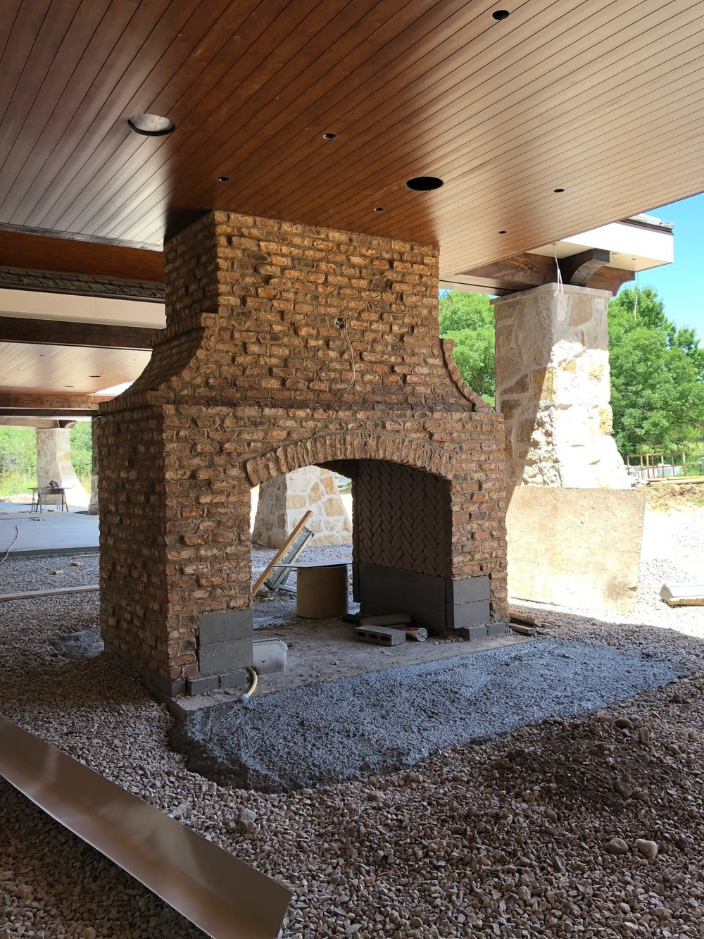 One of the first things you'll see once you step outside is this beautiful double-sided fireplace.