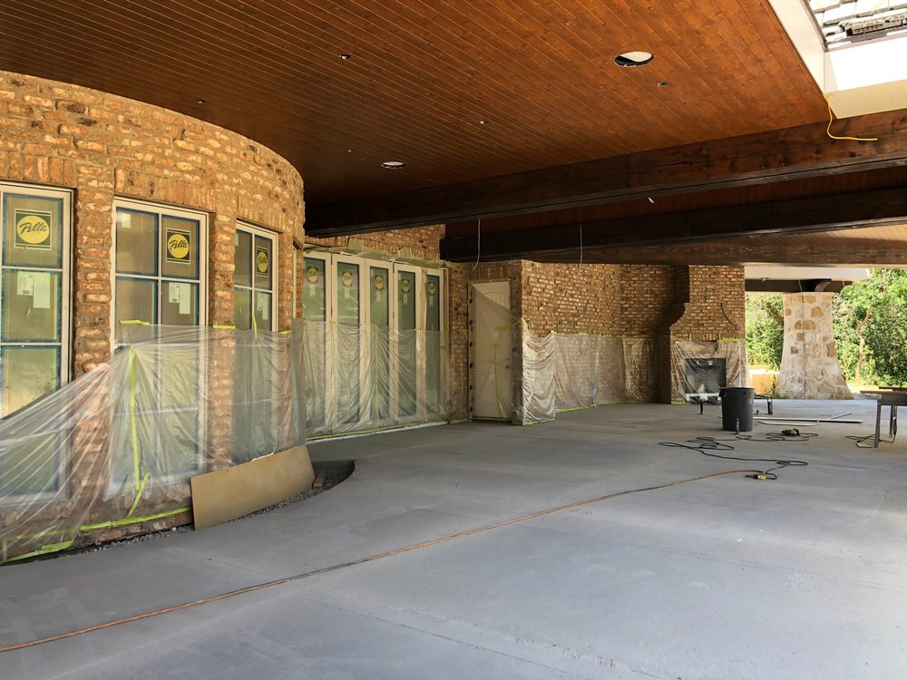 Beyond the big fireplace are the exterior windows for the dining room and hearth room. If you can remember from previous posts, the curved set of windows is where the dining is located. And way in the back of this shot on the right you can see a second fireplace.