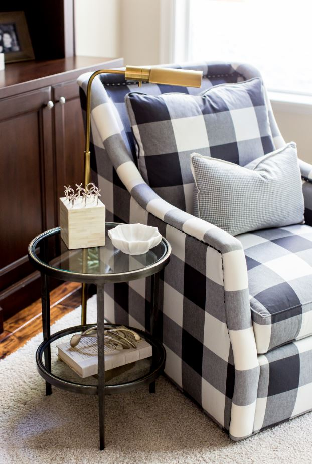 This buffalo check chair looks darling and is super comfortable too, so you really get the best of both worlds. And the gold floor lamp makes it the perfect place to snuggle up and read a book.