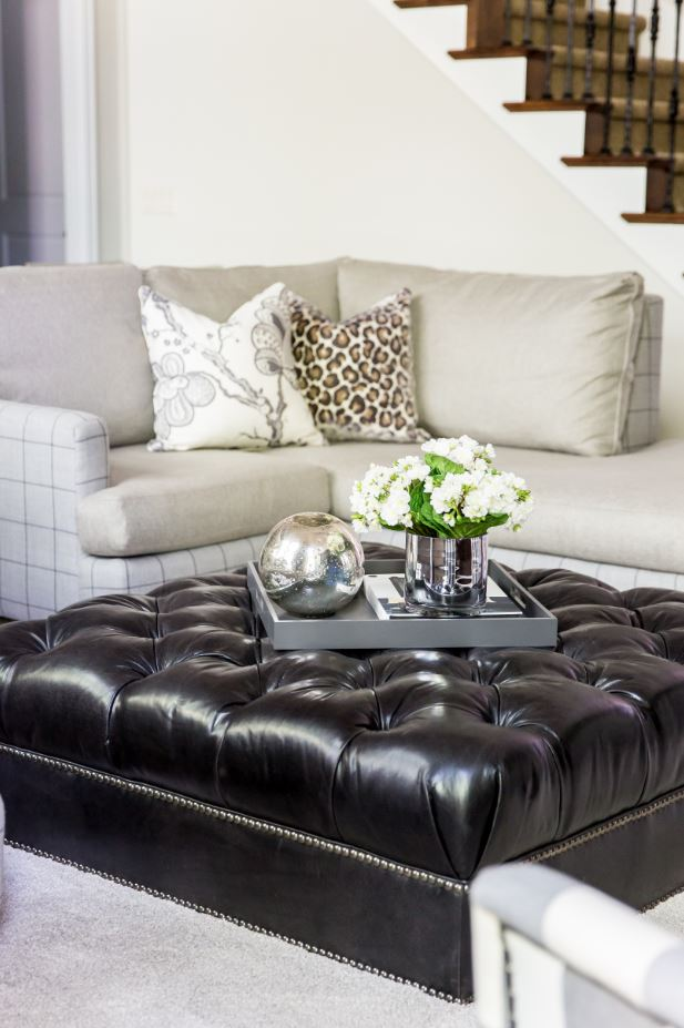 Another great functional piece is a beautiful ottoman like this one! It doubles as a coffee table and provides the perfect place to rest your feet. Checkout the nailhead detail—we think they are perfect!