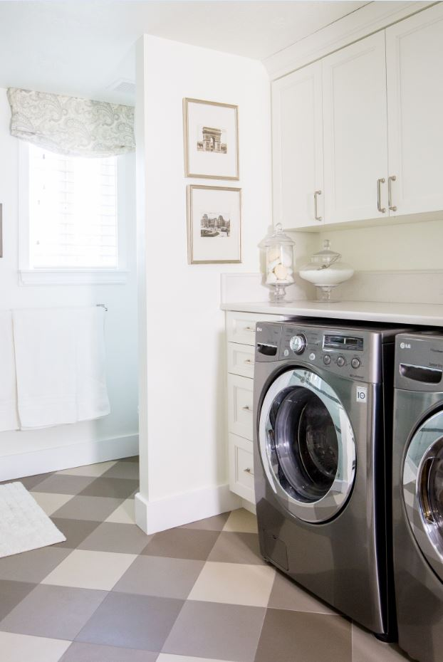 And now, the laundry! With lots of cabinets, drawers, and counter space, doing laundry isn't half bad. Also, we adore the buffalo check tile pattern on the diagonal!