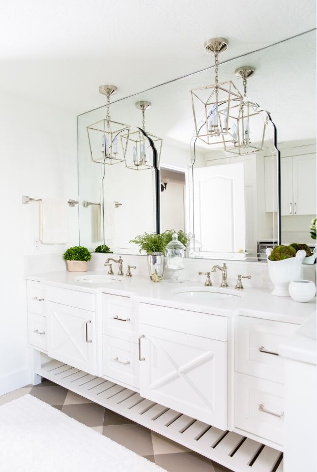 This beautiful custom vanity is our very favorite! It is so clean and fresh and offers endless storage space. We love the overall look and that it is not only gorgeous but functional too!