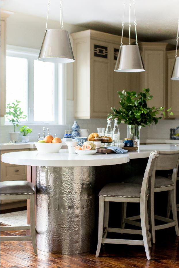 The nailhead detail continues in the kitchen with these amazing barstools, but the real show stopper is this hammered copper island. The silver pendants are also amazing and were the perfect touch that brings the whole space together.