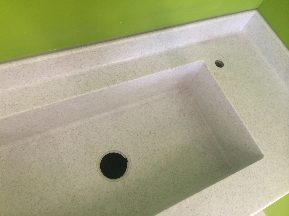 I'm thinking the tiny hole is for the sink bits... (?)
