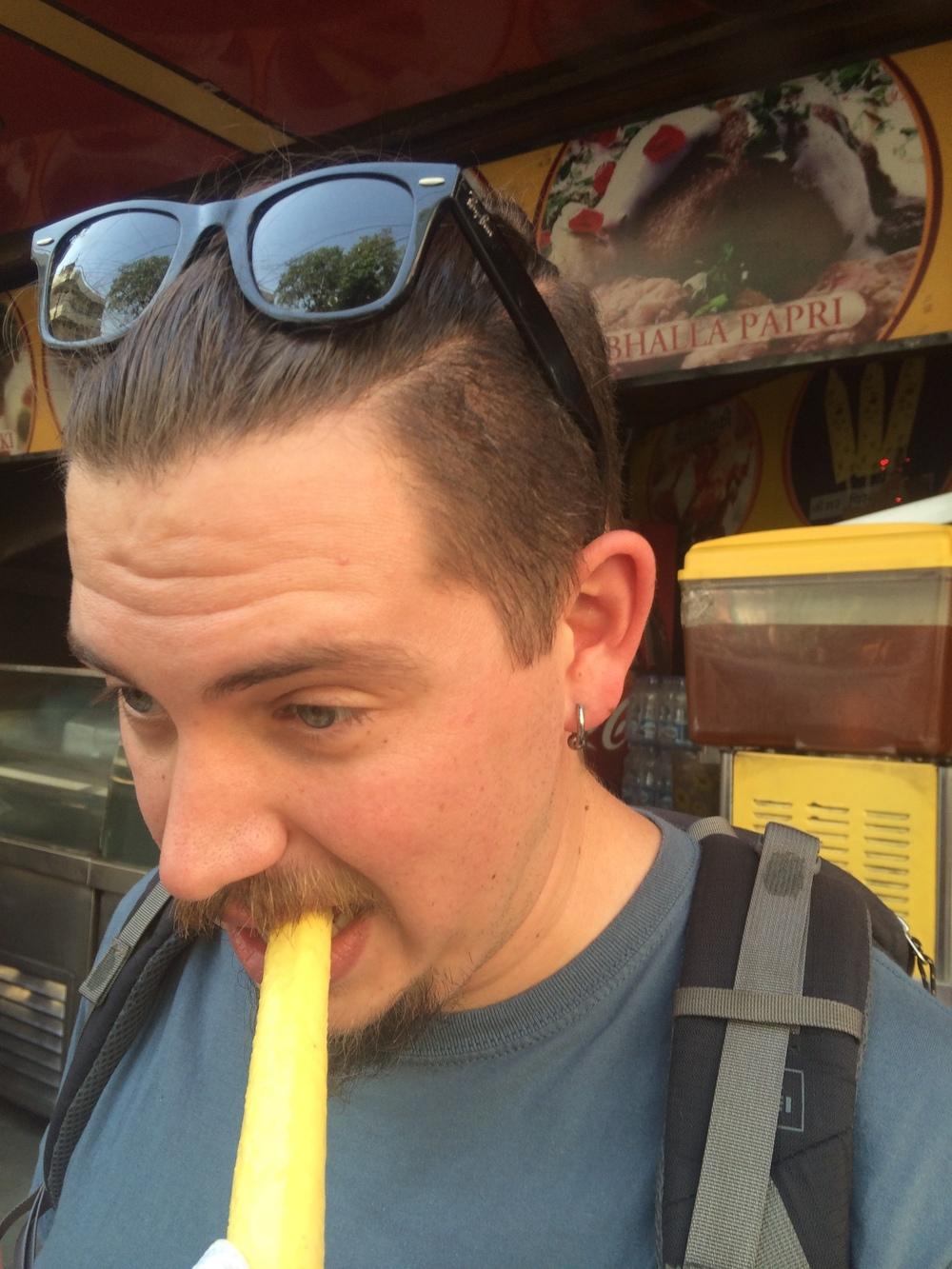 Justin tentatively eating the amazing kulfi!