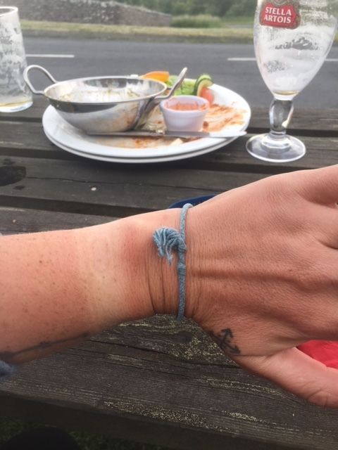My wee little tan line. If you know me, you know I don't tan so this is like...a first! Also in the background you can see the destroyed curry chicken and stella. Exactly what you need after a long day's hike.