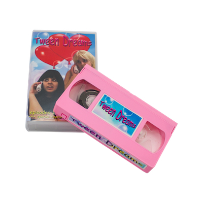 "TZ038 MOLLY SODA ""TWEEN DREAMS"" VHS TAPE EDITION OF 100 NOTES: MOLLY SODA'S LEGENDARY VIDEO SERIES ""TWEEN DREAMS"" FINALLY GETS A PHYSICAL RELEASE IN THE FORM OF THIS LIMITED EDITION VHS ON THUNDER ZONE, PLACING HER IN AN IMPORTANT AMERICAN FREAKOUT CONTINUUM THAT INCLUDES LEGENDS LIKE MISS PUSSYCAT AND TRACY AND THE PLASTICS. CRUCIAL PIECE OF 2010'S DIY, TIMELESS LO-FI COMING OF AGE STYLES UPDATED FOR A NEW GENERATION OF DREAMERS. LIMITED EDITION OF 100 WITH FOLDOUT POSTER. PINK VHS.  BUY VIDEOS 1 2"