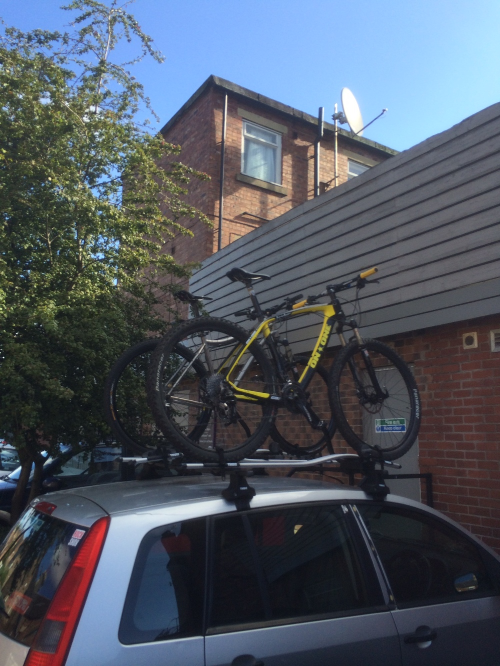 Yes, that's a Ford Fusion. Bikes and rack worth more than car. As it should be.