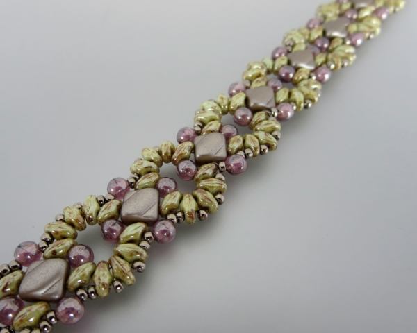 Harmony: NEW CLASS Beginner Level, needle and thread experience recommended. Work with 2 hole silkies and superduos, then accent with 4mm druks, and 11º seed beads.  Makes a lovely bracelet.