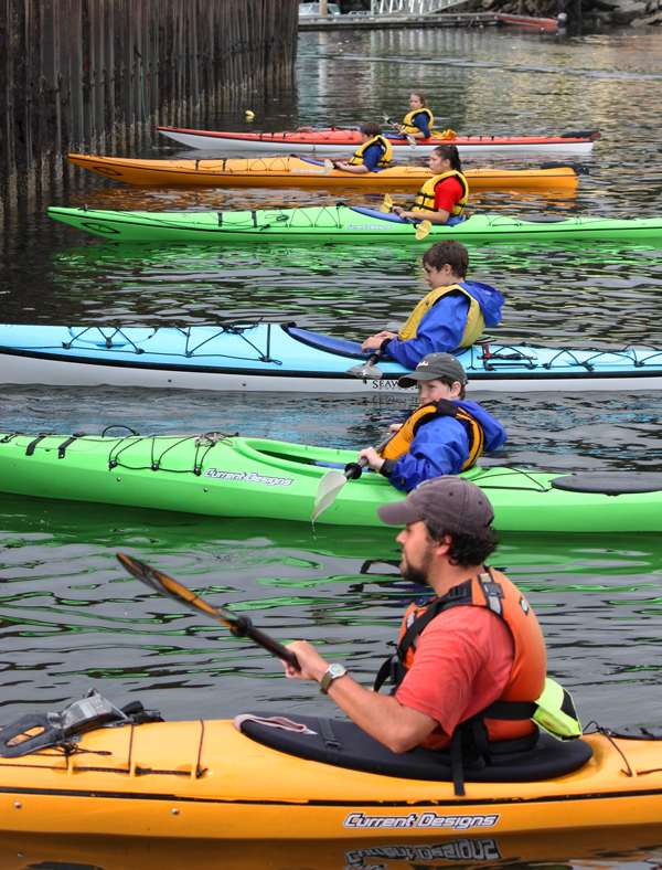Paddling single kayaks requires balance and skill.