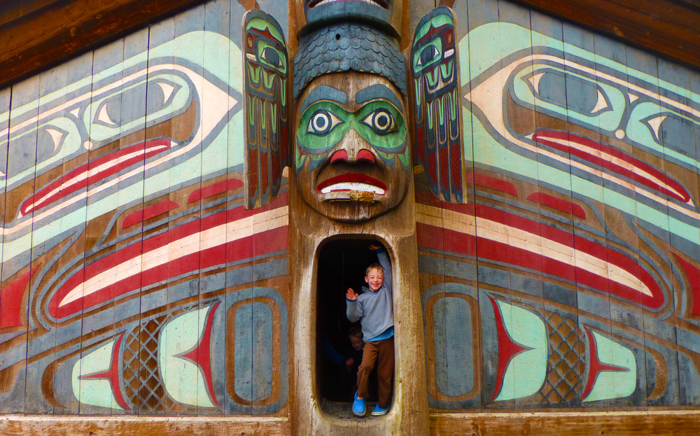Playing hide & seek at Totem Bight State Park, Ketchikan, Alaska.