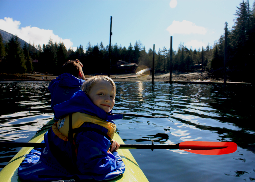 Clancy enjoys the scenery from his center seat in a triple kayak on a beautiful, sunny day here in Ketchikan.