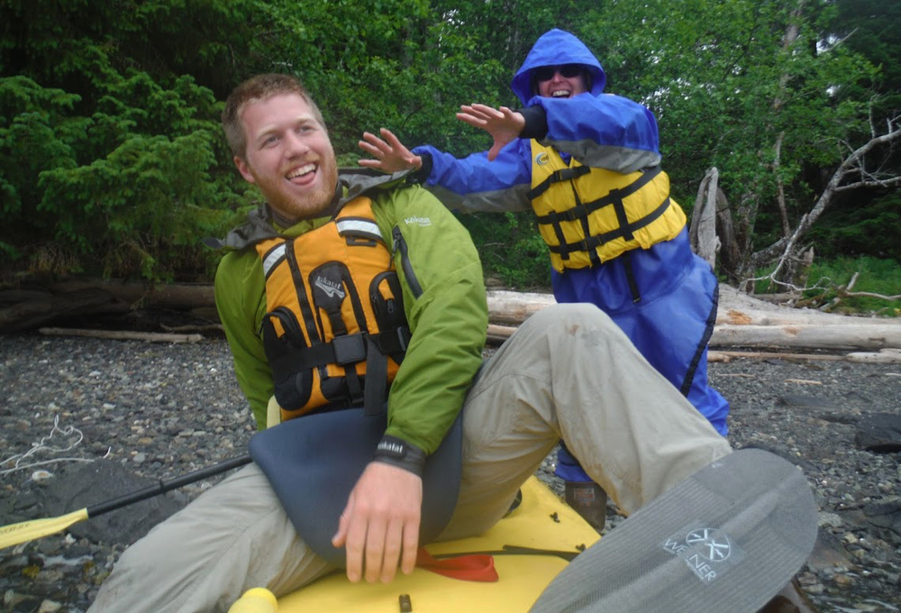 Andre gets a friendly shove from a guest during a lunch break on the Icehouse Cove Kayak/Hike trip.