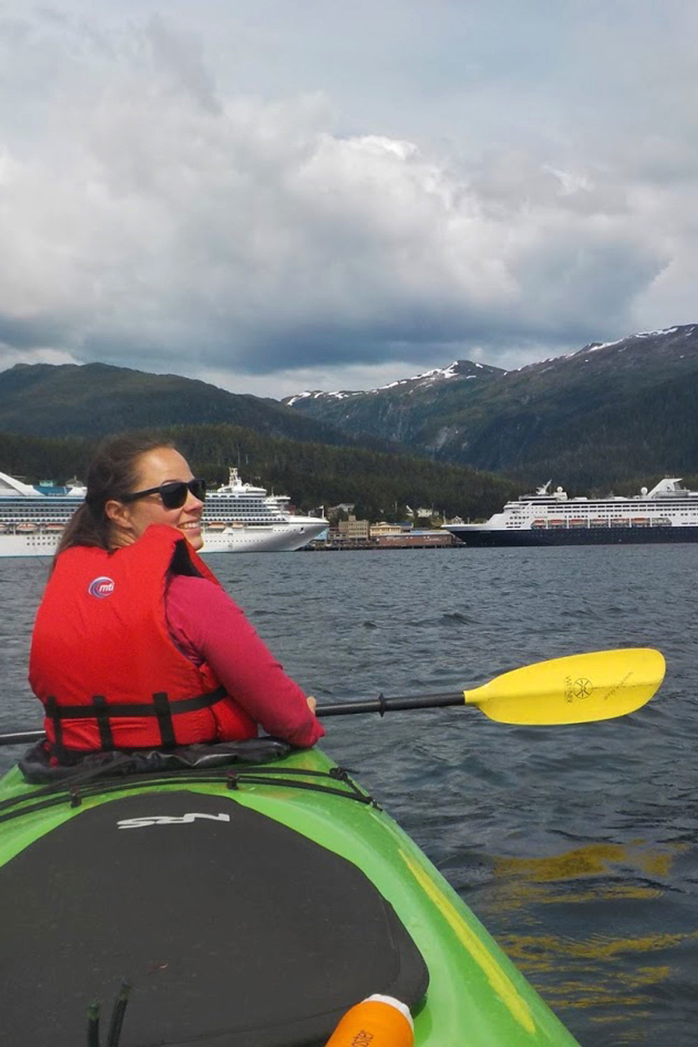 Kayakers catch great views of the town of Ketchikan, Deer Mountain and the cruise ships at the dock in Ketchikan.