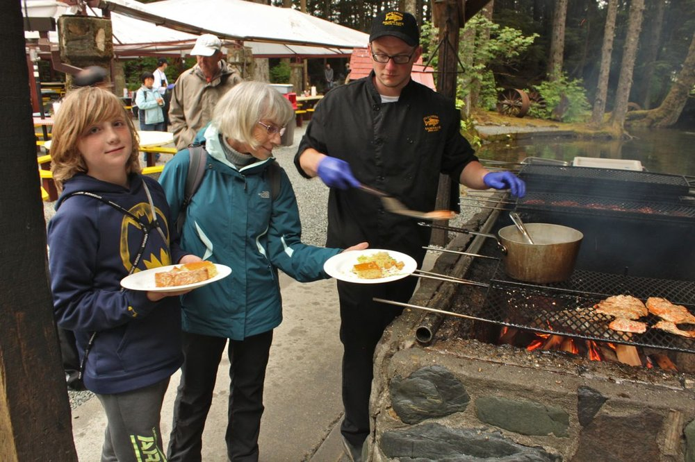 Clancy and Grandma enjoying the food at the Gold Creek Salmon Bake in Juneau, Alaska.