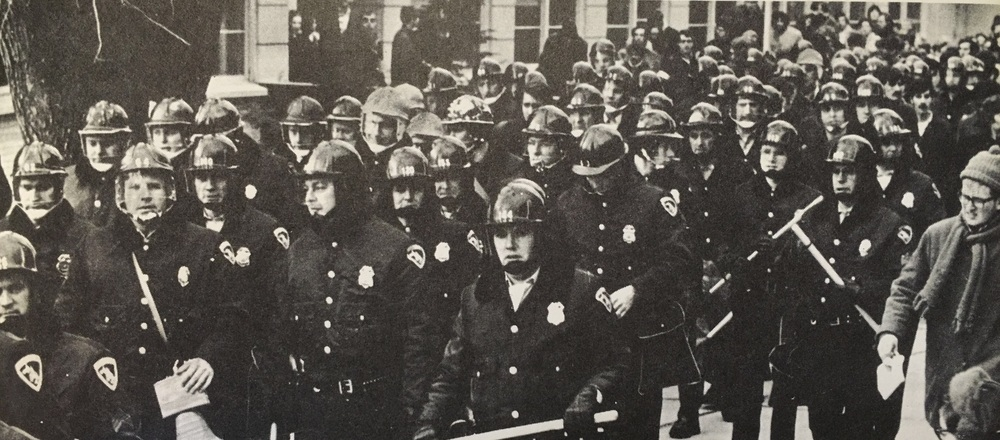 Riot police arrive at the University of Wisconsin's campus.