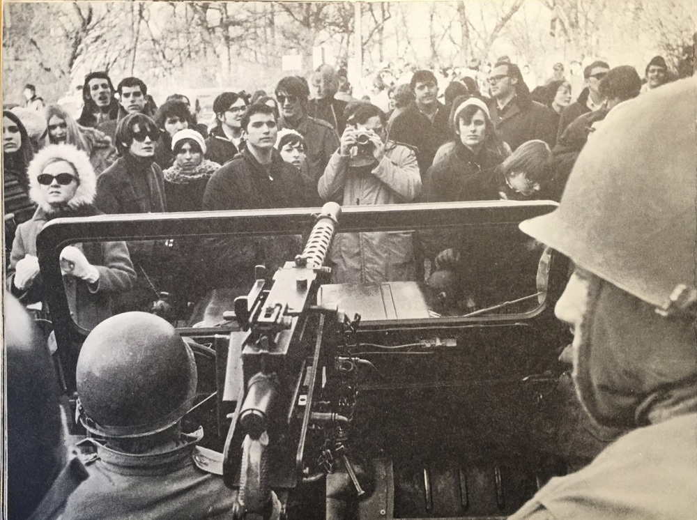 National Guardsmen, some of the 1200 troops called up by Governor Warren Knowles, point their unloaded, Jeep-mounted M1919 .30-caliber machine gun at University of Wisconsin student protesters.