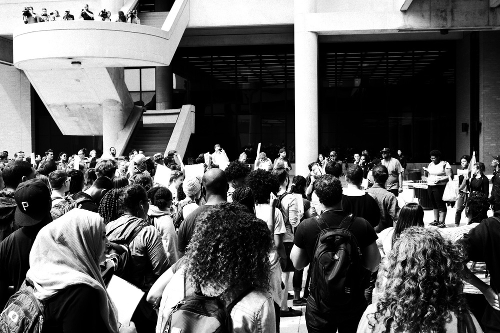 Students chant outside Helen C. White Hall.