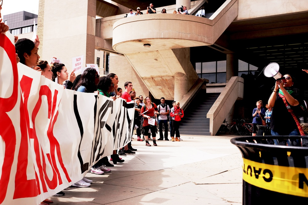Student protesters arrive at Helen C. White Hall, home of the Department of Afro-American Studies and College Library, the main undergraduate library.